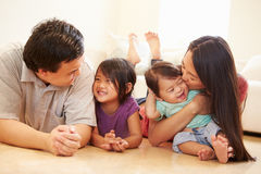 Portrait Of Family Lying On Floor At Home Royalty Free Stock Photo