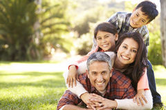 Portrait Of Family Lying On Grass In Countryside Royalty Free Stock Photography