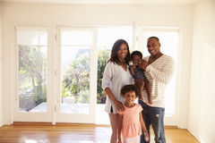 Portrait Of Family In New Home On Moving Day stock photos