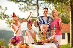 Portrait of a family in party hats and sprinklers royalty free stock image
