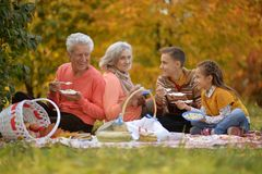 Portrait of family on picnic in autumn stock image
