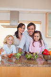 Portrait of a family preparing a salad Stock Image