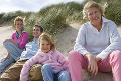 Portrait of family relaxing on beach Stock Photography