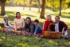 Portrait of family relaxing at park Royalty Free Stock Photography