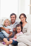 Portrait of a family relaxing on a sofa Stock Photography