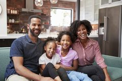 Portrait Of Family Relaxing On Sofa At Home Together royalty free stock photography