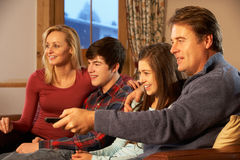 Portrait Of Family Relaxing On Sofa Together Stock Photography