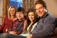 Portrait Of Family Relaxing On Sofa Together Stock Images