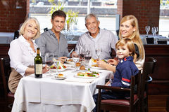 Portrait of family in restaurant. Portrait of a happy smiling family in a restaurant stock image