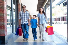 Portrait of a family with shopping bags Stock Photos