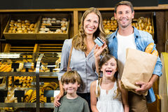 Portrait of family showing credit card Stock Image