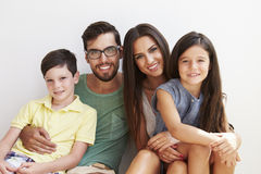 Portrait Of Family Sitting Against Wall Royalty Free Stock Photos