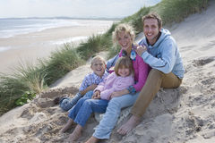 Portrait of family sitting on beach Royalty Free Stock Photo