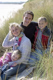 Portrait of a family sitting on a beach Royalty Free Stock Images