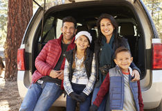 Portrait of family sitting in open back of car before a hike Royalty Free Stock Photo