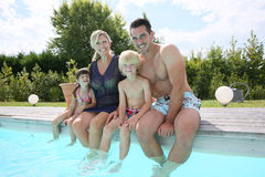 Portrait of family sitting by the pool Royalty Free Stock Image