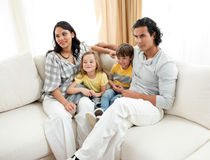 Portrait of a family sitting on sofa Royalty Free Stock Photos