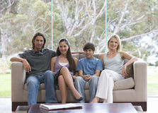Portrait of a family sitting on a sofa stock photography