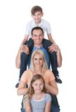 Portrait Of Family With Son On Father's Shoulder. Isolated On White Background Stock Photo