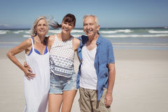 Portrait of family standing at beach. During sunny day Stock Image