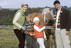 Portrait of family standing near horse Royalty Free Stock Image
