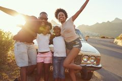 Portrait Of Family Standing Next To Classic Car Royalty Free Stock Photography