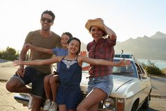 Portrait Of Family Standing Next To Classic Car Stock Photos