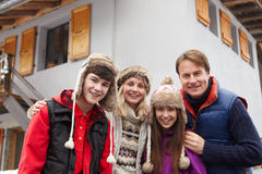 Portrait Of Family Standing Outside Chalet Stock Photography