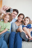 Portrait of a family taking a photo of themselves Royalty Free Stock Photography