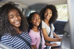 Portrait Of Family With Teenage Children In Car On Road Trip royalty free stock images
