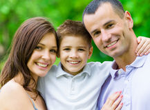 Portrait of family of three. Concept of happy family relations and carefree leisure time royalty free stock images