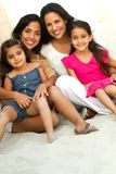 Three generations of hispanic woman smiling. Portrait of a family. Three generations of women Stock Photography