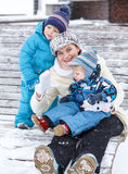 Portrait of family of three: mother, two little siblings boys Stock Photography