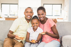 Portrait of a family of three watching tv Stock Photo