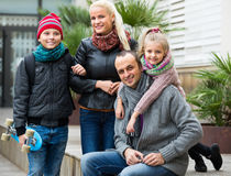 Portrait of family with two kids outdoors Stock Photo