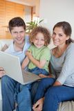 Portrait of a family using a laptop Royalty Free Stock Images