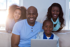 Portrait of family using laptop. At home stock photography