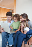 Portrait of a family using a notebook Royalty Free Stock Photo