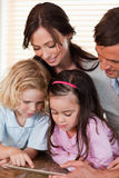 Portrait of a family using a tablet computer together Stock Photo