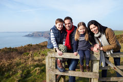 Portrait Of Family Walking Along Coastal Path Royalty Free Stock Photo