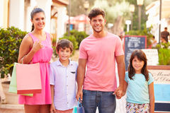 Portrait Of Family Walking Along Street With Shopping Bags royalty free stock images