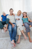 Portrait of a family watching television Royalty Free Stock Image
