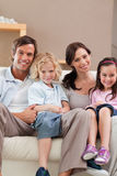 Portrait of a family watching television together Stock Image