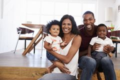 Portrait Of Family With Young Children At Home Together royalty free stock images