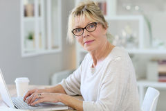 Portrait of fancy senior woman on laptop Royalty Free Stock Photo