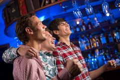 Portrait of the fans in the bar stock images