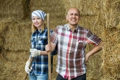 Portrait of farm employees in hayloft Royalty Free Stock Image