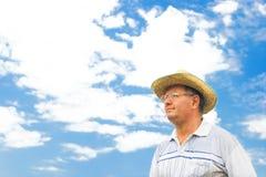 Portrait of a farmer. Against blue sky Stock Image