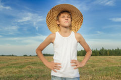 Portrait of farmer boy on harvested field Stock Photo