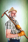 Portrait of farmer with his mattock Stock Photos